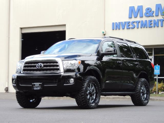 2016 Toyota Sequoia SR5 / 4WD / Third Seat / Sunroof / Backup / LIFTED - Photo 1 - Portland, OR 97217