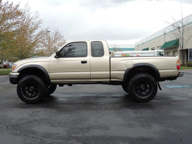 2003 Toyota Tacoma 2dr Xtracab V6 / SR5 / 4X4 / 5-SPEED MANUAL/LIFTED - Photo 3 - Portland, OR 97217