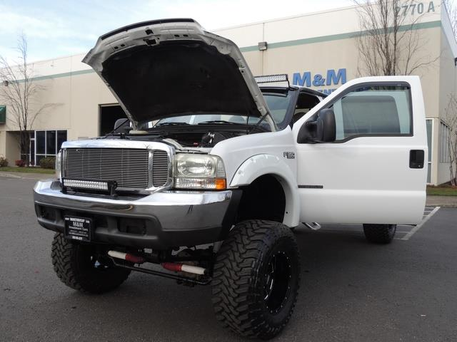 2000 Ford F-350 LARIAT 4X4 LONG BED / 7.3 DIESEL / MONSTER LIFTED - Photo 25 - Portland, OR 97217