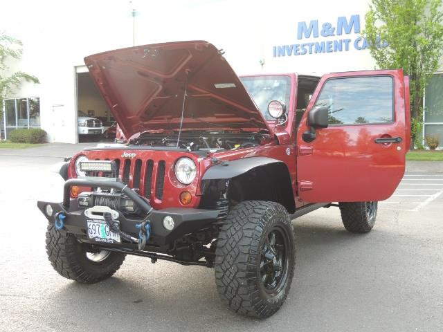 2011 Jeep Wrangler Unlimited Sport / 4X4 / 6-SPEED / LIFTED - Photo 25 - Portland, OR 97217