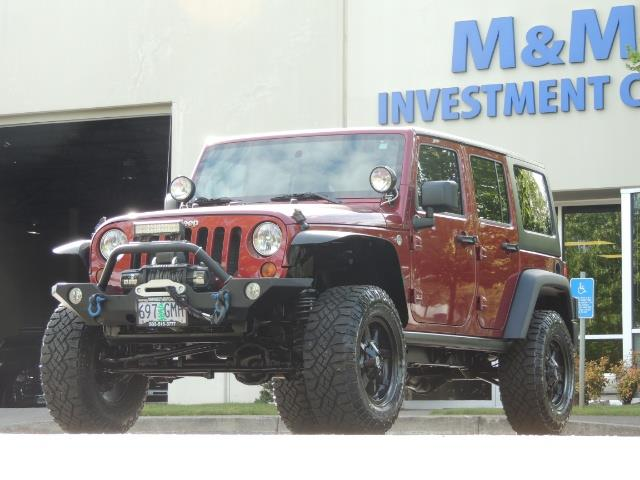 2011 Jeep Wrangler Unlimited Sport / 4X4 / 6-SPEED / LIFTED - Photo 47 - Portland, OR 97217