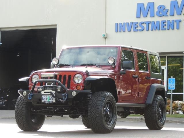 2011 Jeep Wrangler Unlimited Sport / 4X4 / 6-SPEED / LIFTED - Photo 45 - Portland, OR 97217