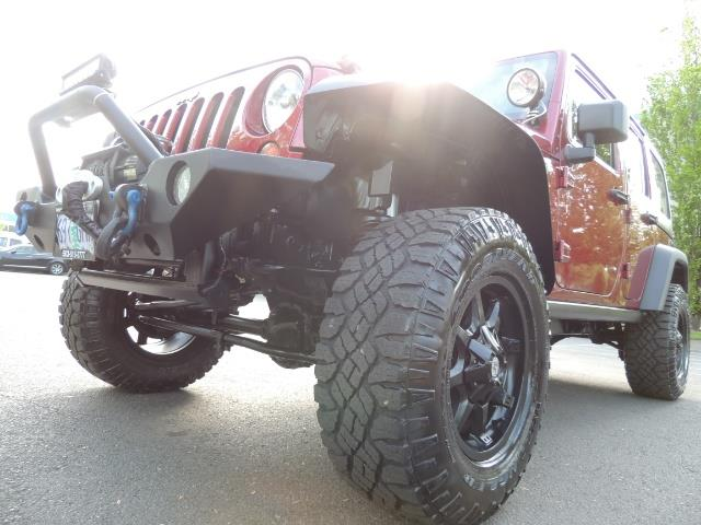 2011 Jeep Wrangler Unlimited Sport / 4X4 / 6-SPEED / LIFTED - Photo 41 - Portland, OR 97217
