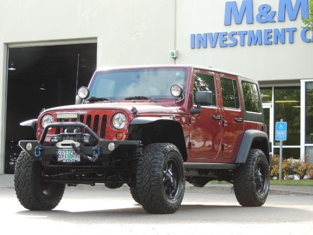2011 Jeep Wrangler Unlimited Sport / 4X4 / 6-SPEED / LIFTED - Photo 1 - Portland, OR 97217