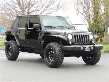 2014 Jeep Wrangler Unlimited Sport / 4DR / 4X4 / LIFTED / 6-SPEED SUV
