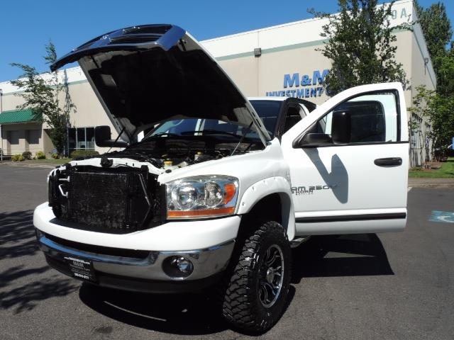 "2006 Dodge Ram 2500 Laramie 5.9L Quad Cab 4WD LIFTED / 35 ""MUD LOWMILES - Photo 25 - Portland, OR 97217"