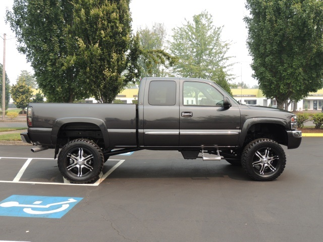 2003 gmc sierra 1500 4dr extended cab lifted leather new 35 mud tires. Black Bedroom Furniture Sets. Home Design Ideas